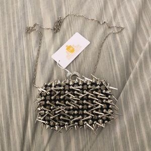 Spiked silver black clutch
